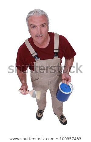 Middle-aged decorator holding paint tin and brush Stock photo © photography33