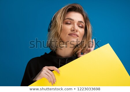 Beautiful young woman standing by the blank baord stock photo © get4net