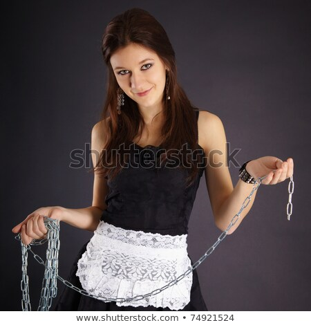 Young beautiful girl in maid costume with a chain Stock photo © pzaxe