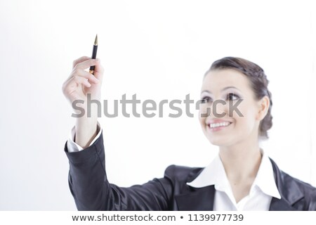 Pretty girl showing pencil upwards stock photo © stockyimages