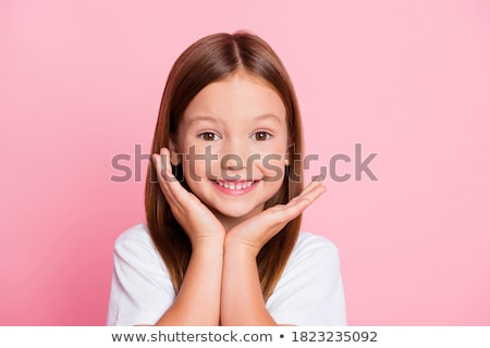 Close up of a smiling school girl stock photo © stockyimages