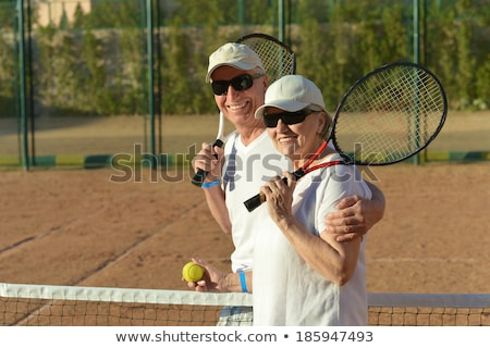 Elderly couple playing tennis stock photo © photography33