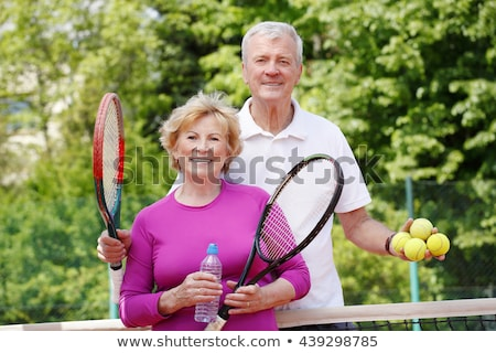 Elderly couple playing tennis together stock photo © photography33