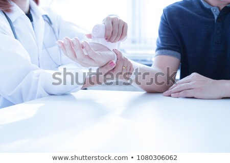 Female doctor bandaging a wrist Stock photo © photography33