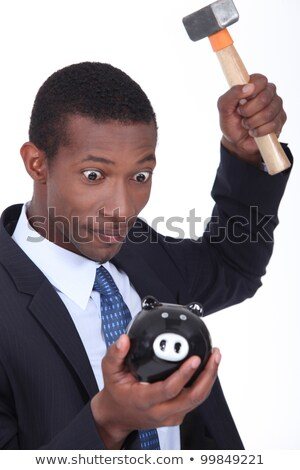 insane man smashing open a piggy bank with a hammer stock photo © photography33