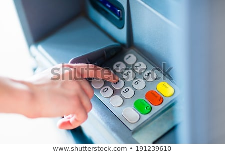 Photo stock: Atm Machine Keypad Numbers Entering Pin Code