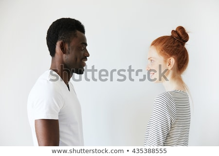 Beautiful couple smiling and facing each other Stock photo © get4net