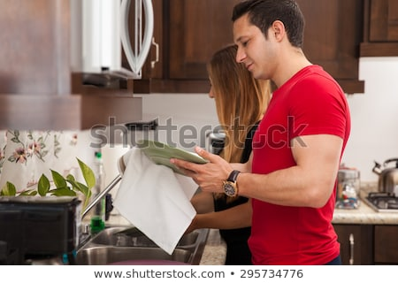 Atraente mulher jovem pratos cozinha casa beleza Foto stock © wavebreak_media