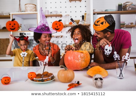 Young family carving hallowe'en pumpkins Stock photo © photography33