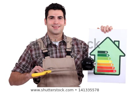 happy craftsman holding money in cash and a pig bank Stock photo © photography33