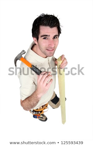 carpenter stood with plank and hammer stock photo © photography33