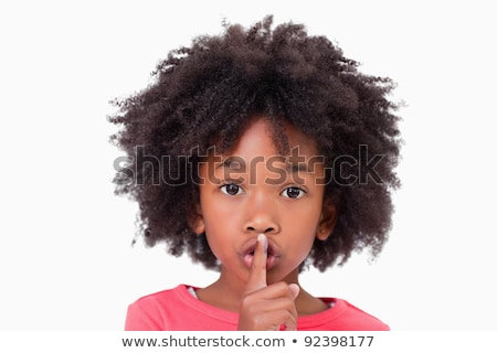 Girl asking for silence against a white background Stock photo © wavebreak_media