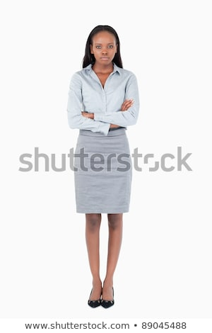 Portrait of a serious office worker posing with the arms crossed against a white background Stock photo © wavebreak_media