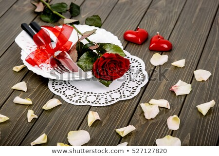 forks surrounding heart shape and rose petals Stock photo © morrbyte