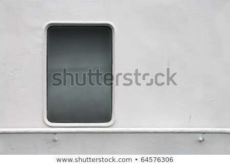 Old window at the gray vessel wall Stock photo © pzaxe