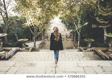 Genç kadın yürüyüş park gün batımı gündoğumu bacaklar Stok fotoğraf © studio1901