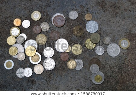 different old coins stacked on the ground stock photo © len44ik