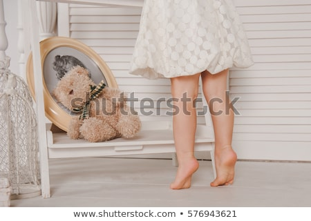 Tiptoe little girl Stock photo © sahua