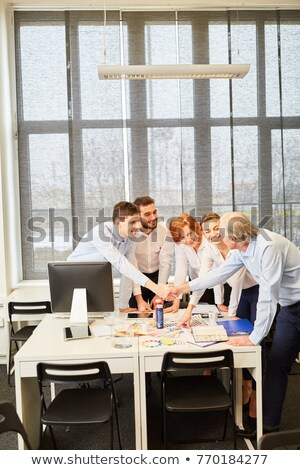 A handshake between business people Stock photo © stockyimages