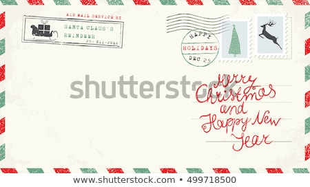 christmas envelope with santa claus and deer with gifts stock photo © elmiko
