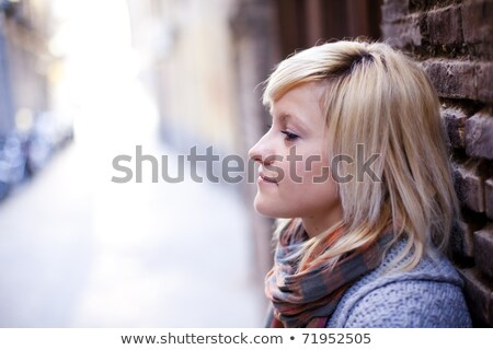 Serene blond teenager on white Stock photo © DNF-Style