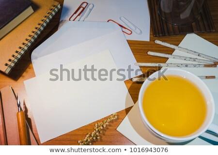 yellow document envelopes on wooden tabletop stock photo © stevanovicigor