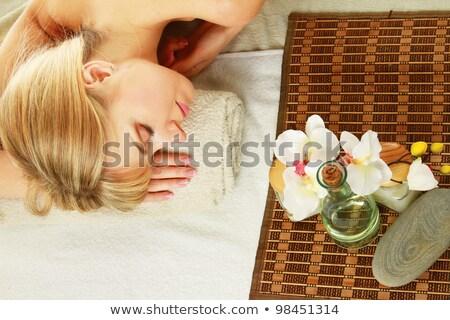 Stock fotó: Gyönyörű · fiatal · nő · orchidea · virág · izolált · fehér