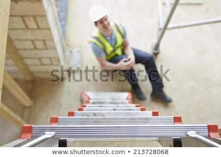 bouwvakker · vallen · werk · Blauw · werknemer · hoed - stockfoto © highwaystarz