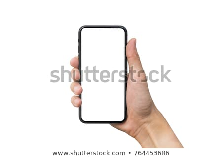 man hand holding a smart phone on a green background stock photo © jaylopez