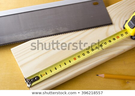 Hand saw cutting through a beam of wood Stock photo © juniart