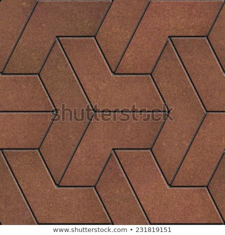 brown paving slabs in the trefoils form stock photo © tashatuvango