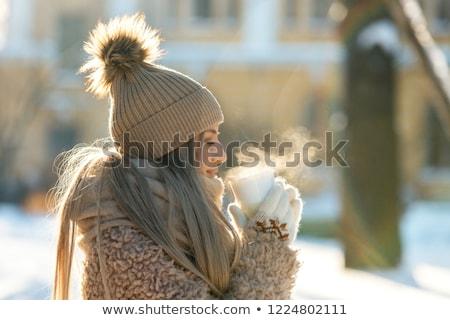 Kadın kış elbise sıcak içecek gözleri kapalı Stok fotoğraf © HASLOO