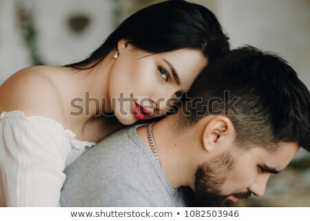 young man looking down while leaning on his girlfriend Stock photo © feedough