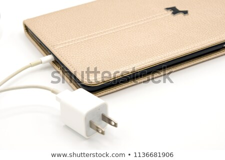ipad with brown case isolated on white Stock photo © artjazz