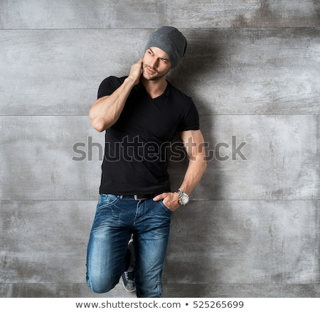 Muscular young man in jeans. Stock photo © NeonShot