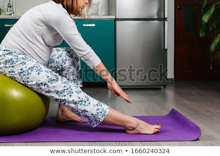 Pilates woman fitball side bend exercise workout Stock photo © lunamarina