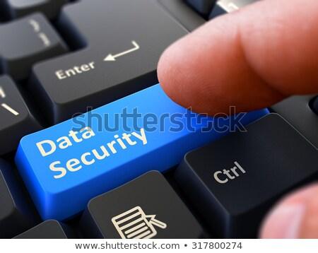 Segurança de dados pessoa clique teclado botão azul Foto stock © tashatuvango