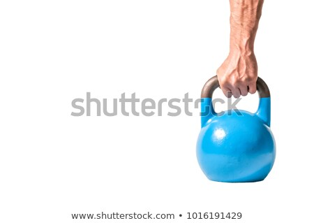Kettle ball holded by man's hand Stock photo © deandrobot