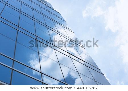 kék · tükör · üveg · homlokzat · felhőkarcoló · épületek - stock fotó © lunamarina