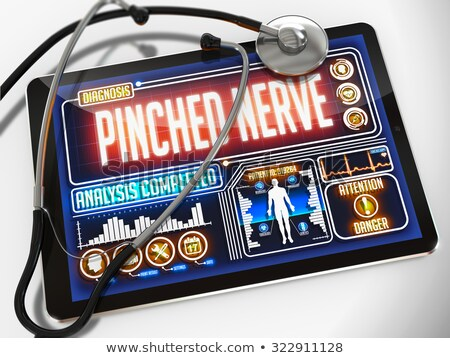 pinched nerve on the display of medical tablet stock photo © tashatuvango