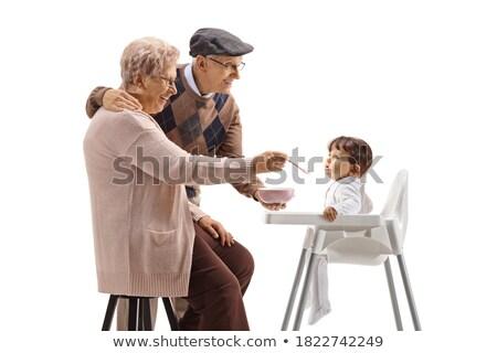 Grandmother with grandfather nourish child Stock photo © Paha_L