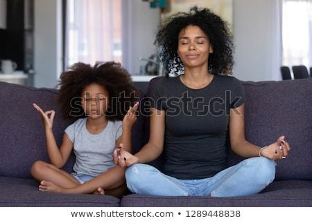 duas · mulheres · juntos · sentar-se · pose · lótus · mulher - foto stock © Paha_L