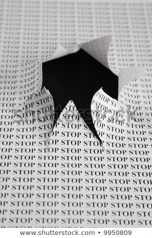 the sheet of paper with printing word stop and the cut hole against the black background Stock photo © Paha_L