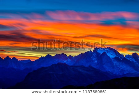 Orange summer sunset with mountains silhouette. Stock photo © tuulijumala
