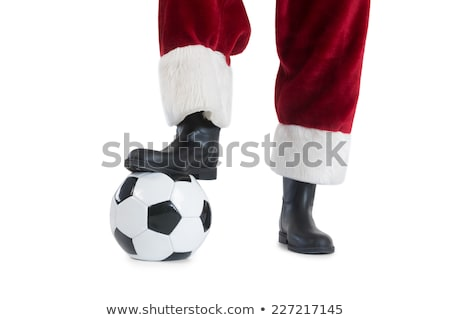 Man in red outfit playing soccer Stock photo © bluering