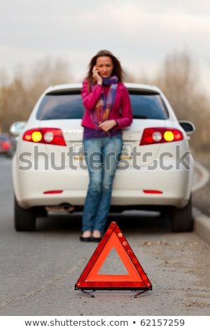 Stock photo: Beautiful Girl In Car Repair Service With Wheel
