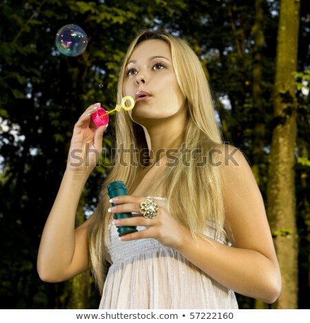 thoughtful woman blowing soap bubbles stock photo © ssuaphoto
