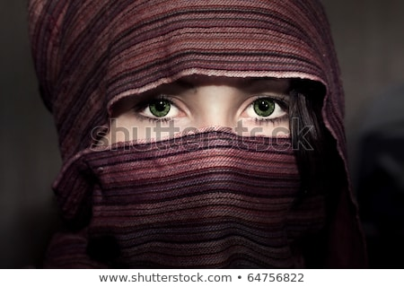 A young middle eastern woman wearing a purple head covering. Stock photo © konradbak