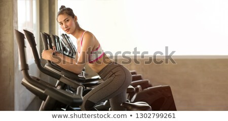 Attractive, beautiful Asian girl in gymnasium. Stock photo © O_Lypa