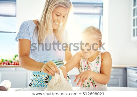 Fascinated little girl learning to bake Stock photo © dash